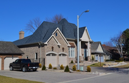 In the suburb of Hamilton on the lake Ontario a new big mansion is build,photo taken under sunny sky in early spring  Stock Photo - 13289766