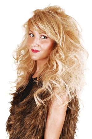 A portrait of a young woman in a fur top and long curly blond hair,looking into the camera, for white background  photo