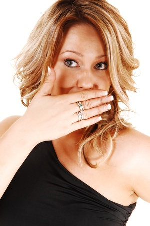eyewitness: A closeup shoot of a very surprised blond woman, holding herhand for her mouth, looking upset, for white background