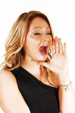 A head shoot of a young woman with blond hair, holding her hand onher mouth and yelling with open mouth, for white background  photo