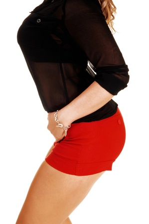 The mitt section of a young sexy woman in red shorts and a blackblouse, showing her nice curves in closeup over white background  photo