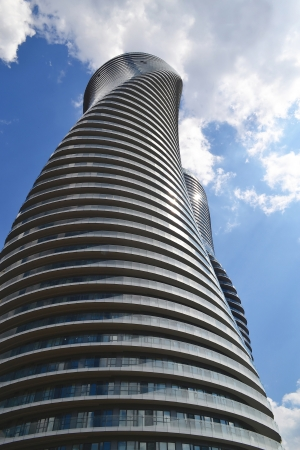 The look up of two twisted round high rise condominium buildingsin Mississauga Ontario, Canada  photo