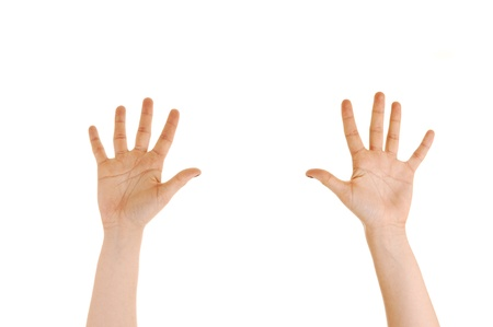 The hands of a young woman reaching high with the palms to thecamera on white background
