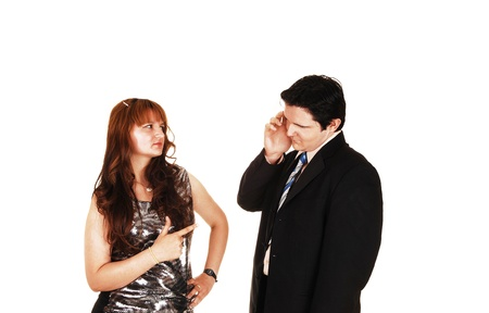 A young couple standing in the studio and arguing with each otherwell dressed, for white background  photo