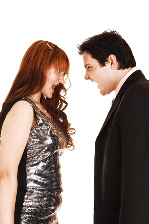 A young couple screaming at each other in the studio for whitebackground, they are well dressed  photo