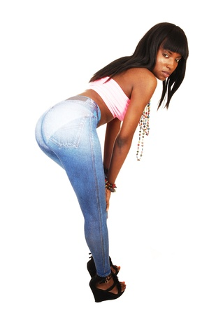A lovely African American woman in thin blue tights bending down andshowing her nice round butt for white background  photo