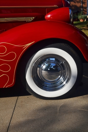 The front tires with the headlights of an antique red old timer Buick from around 1936  photo