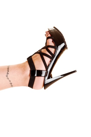 The foot of a young woman with a tattoo on her ankle and beautiful blackhigh heels for white background   Stock Photo - 15867910