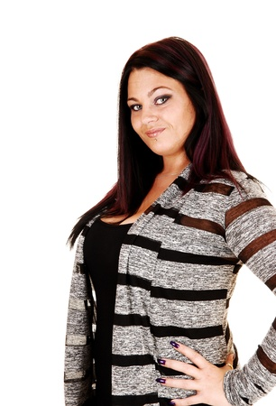 A full figured young woman standing for white background whit her collared hair, smiling into the camera  photo