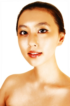 A portrait shot of a young Asian woman with her hair tight in her back, wearinga shoulder less dress for white background  photo