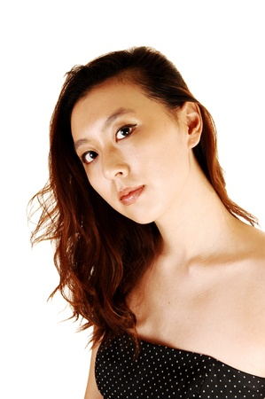 A portrait shot of a young Asian woman with her hair falling on one side, wearing a shoulder less dress for white background  photo
