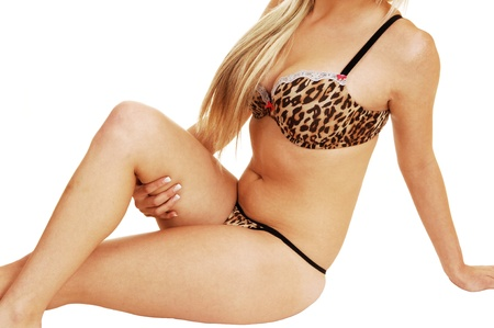A closeup shot of the body of a young slim woman in brown lingerie andblond hair for white background  photo