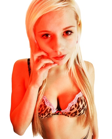 A closeup shot of a young woman in a brown leopard colours bra and long blond hair for white background with red light from one side   Stock Photo - 17544641