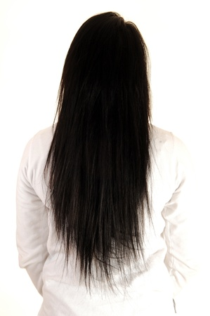 A teenager standing from the back on white background showing off hernice long black hair  Stok Fotoğraf
