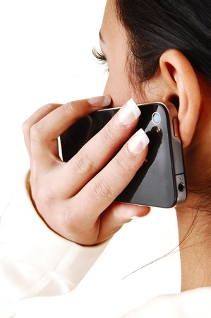 mobile communication: A closeup shoot of a young teen girl from the back with her cell phone on her ear for white background  Stock Photo