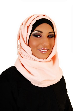 A young lovely teenager girl in a black jacket and a pink headscarf forwhite background, a portrait shoot of the girl smiling  photo