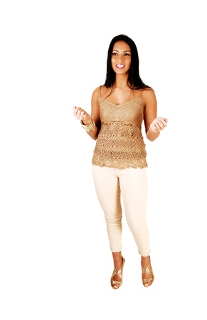 A very pretty teenager girl standing in the studio for whitebackground in white dress pants with her long black hair  photo