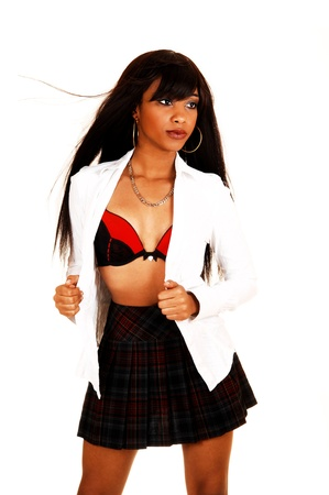 woman bra: A lovely young black woman in a skirt and open white blouse, showing hernice red and black bra, for white background, with her long brunette hair  Stock Photo