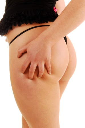 A body part closeup shoot of the bottom of a young woman in blacklingerie, showing her to big butt, for white background  photo