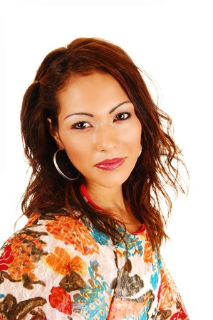 A closeup portrait of a beautiful native Canadian woman in a colorfulblouse, looking into the camera, for white background  photo