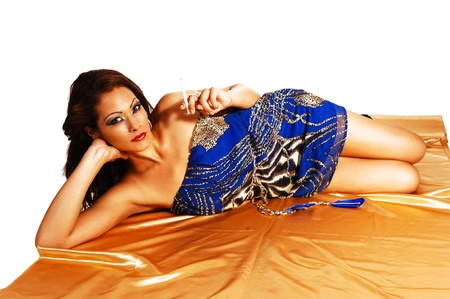 A young pretty native Canadian women lying on the floor in a blue summerdress, smoking a cigarette for white background  photo