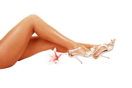 Beautiful legs of a young woman, lying on her back, over white background