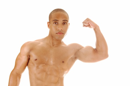 jamaican man: A Jamaican young man standing from the front and shoeing his biceps