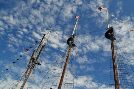 Three masts of an tall ship under light cloudy sky in the harbour of HamiltonOntario, Canada  photo