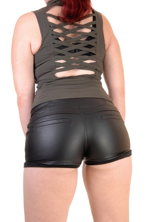 red pants: A body picture on a young woman in black leather shorts and a olive greentop for white background