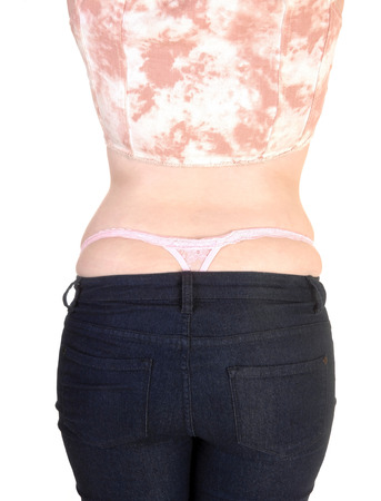 A body part picture of a woman from the back in jeans photo