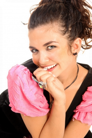 A lovely young woman kneeling on the floor, smiling, in a black and pink costume for white  photo