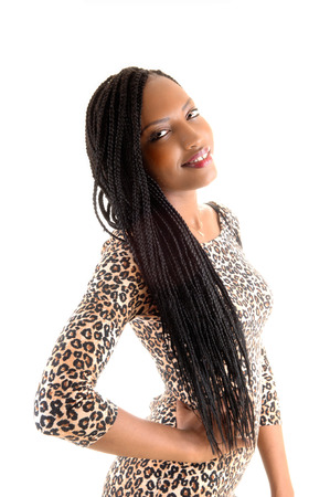 A portrait picture on a lovely young black woman with long braid hairstanding for white background