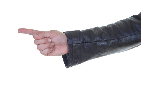 An arm of a man in a brown leather jacket pointing with his finger Banco de Imagens