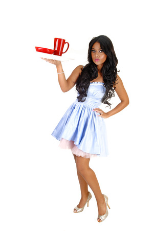 A lovely young Asian woman in a light blue dress and long black hair holdingup a tray with a red cup for white background Stock Photo - 23821117