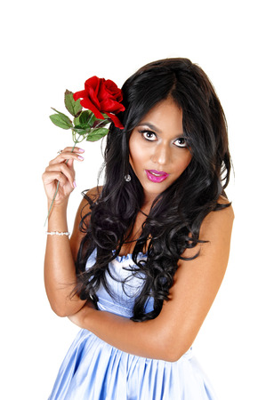 A portrait picture of a beautiful young Asian woman whit long black hairholding a red rose, for white background Stock Photo - 23820936
