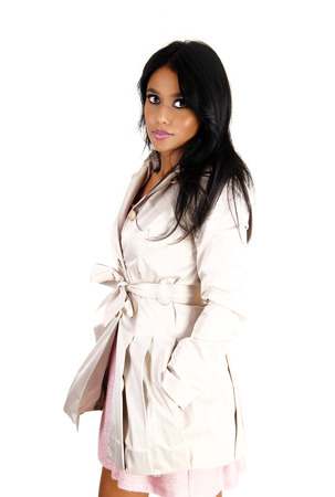 A lovely young Asian woman in a white coat and long black hair standingfor white background  photo