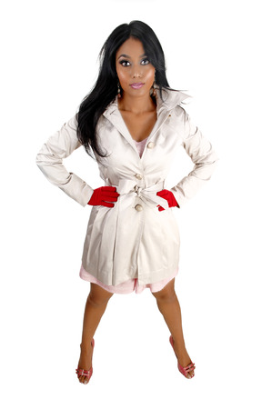 A lovely young Asian woman in a white coat and red mittens standingfor white background  photo
