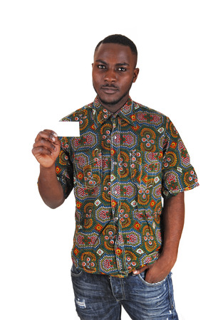 businesscard: A young black man in a colorful shirt and jeans holding a white businesscard in his hand for white background