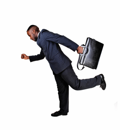 A black business man with his briefcase is running for white backgroundin a blue suit