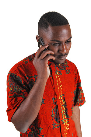 A handsome young black man in a colorful shirt talking on a cell phonefor white background  photo