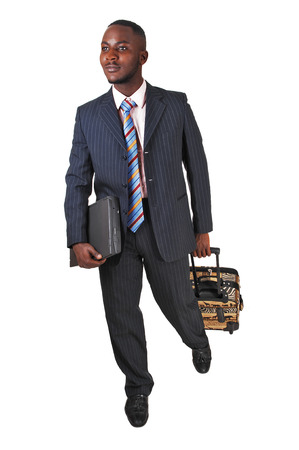 A black business man with his briefcase is running for white backgroundin a blue suit Stock Photo - 24822575