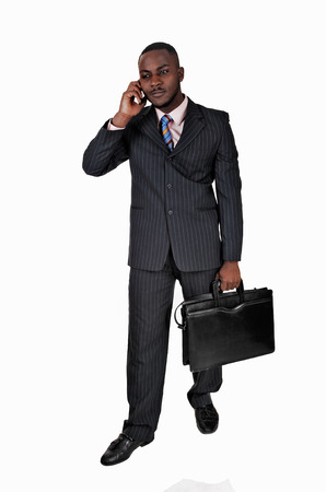 A talking black young man in a blue suit and briefcase standing on white background  photo