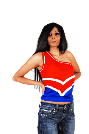 A portrait picture of a young Hispanic woman in a blue red top standing on white background  photo