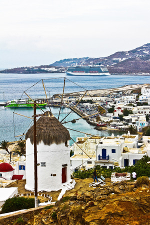 The harbour from Mykonos Greece, and a windmill with white houses inthe Mediterranean see   photo
