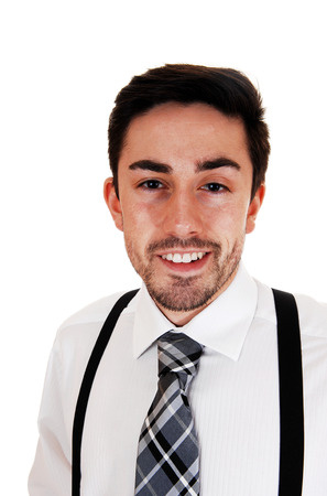 A closeup picture of a young man in a white shirt and black suspendersmiling for white background