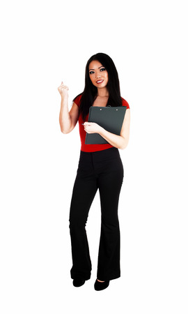 A beautiful young slim Asian business woman in black dress pants andlong black hair standing for white background  photo