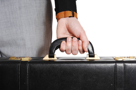 A closeup picture of the hand of a man holding his briefcase, isolatedfor white background  photo