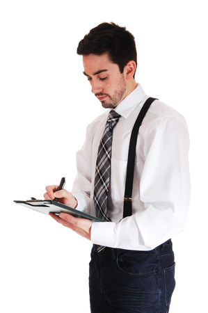 suspender: A young man in a white shirt and black tie and suspender writing onhis clipboard, isolated for white background  Stock Photo