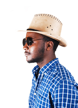 A serious looking black man in a profile picture with a cowboy hat, andsunglasses, isolated for white  photo