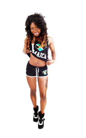 A pretty Jamaican woman in exercise outfit and on longblack and brown hair standing isolated for white background  photo